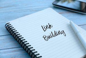 link building written on notebook in pen